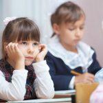 Small Schoolgirl in classroom. Interesting lecture