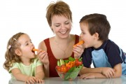 Happy kids eating vegetables
