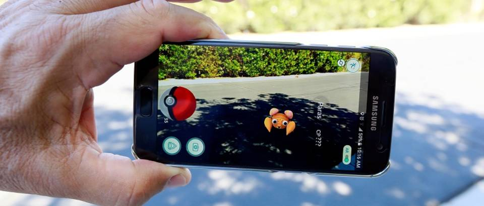 "Illustration of the augmented reality mobile game ""Pokemon Go""The augmented reality mobile game ""Pokemon Go"" by Nintendo is shown on a smartphone screen in this photo illustration taken in Palm Springs, California U.S. July 11, 2016.  REUTERS/Sam Mircovich/IllustrationSAM MIRCOVICH"
