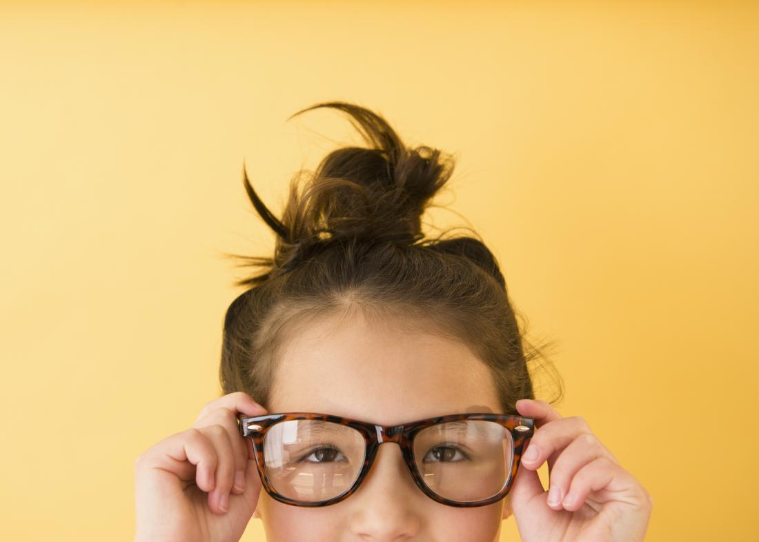 Mixed race girl wearing glasses